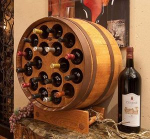 French Oak Wine Barrel wine rack with bottle holes is just another awesome way to store those signature wines for the collector. The Unit can be mounted to a wall or be used as a free standing unit.